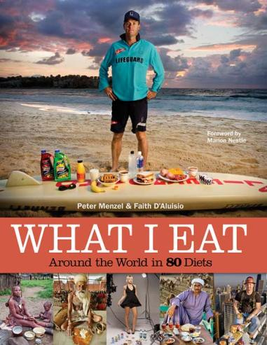 Cover of the book What I Eat, showing a man in running clothes standing in front of a variety of food stuffs.